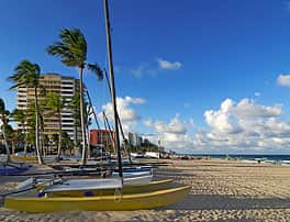 Small catamarans lined up on the Fort Lauderdale beach in Florida